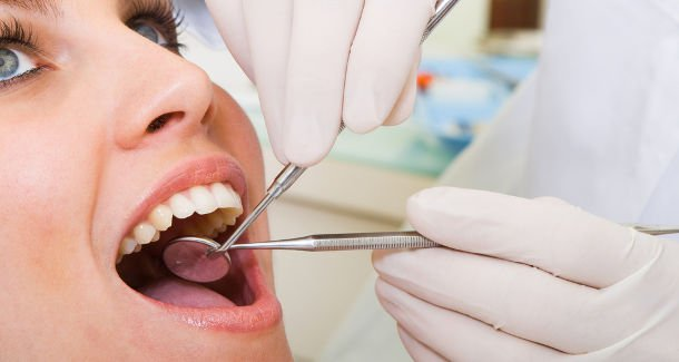Periodontitis: Symptoms and Treatment